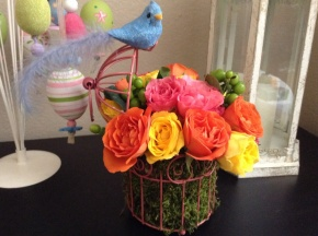 Flowers In ABirdcage